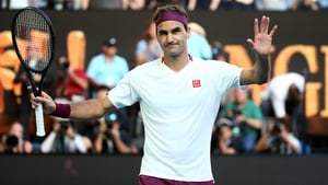 Roger Federer celebrates in almost sheepish fashion after falling over the line in Melbourne
