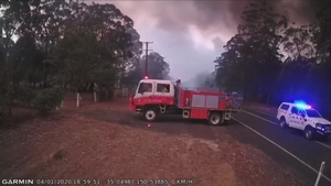 The crew quickly got into their vehicles and left the scene, moments before the road was engulfed in flames