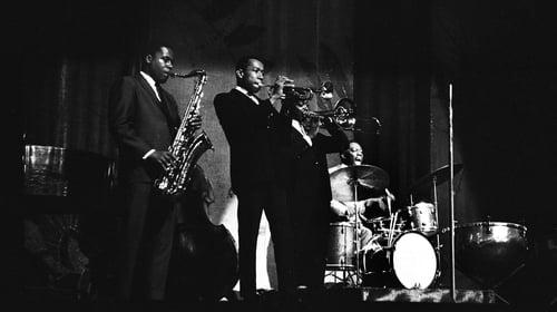 Tenor saxophonist Wayne Shorter, trumpeter Freddie Hubbard, trombonist Curtis Fuller with bandleader/drummer Art Blakey at the Apollo Theater in Harlem, New York in 1964