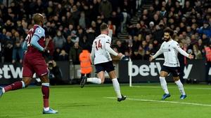 Mo Salah celebrates his first-half goal against West Ham