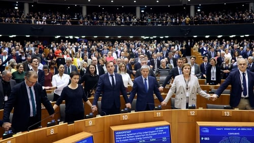 MEPs burst into a chorus of 'Auld Lang Syne' following the vote