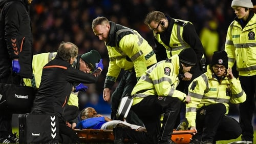 Jermain Defoe is stretchered from the pitch at Ibrox