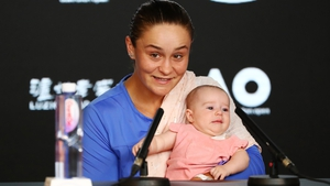 Ashleigh Barty, with her niece Olivia, faces the press after her Australian Open semi-final defeat to Sofia Kenin.