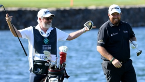 Shane Lowry (R) is in action