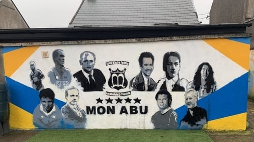 Among those included in the mural by artist Alan Hurley are Terence MacSwiney,  the late taoiseach Jack Lynch; sportsmen Tomás Mulcahy & Seán Óg Ó hAilpin; the late actor Niall Tobin and famous rock guitarist Rory Gallagher
