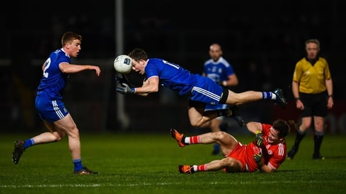 Jack McCarron and Kieran Duffy (l) of Monaghan in action against Tyrone's Kieran McGeary during last year's league clash between the counties