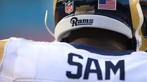 Lineman Michael Sam #96 of the St. Louis Rams prepares to play against the Miami Dolphins during a preseason game in 2014