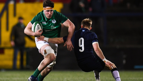 Ireland's David McCann is tackled by Roan Frostwick of Scotland