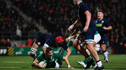 Jack Crowley goes over for Ireland's first try against Scotland