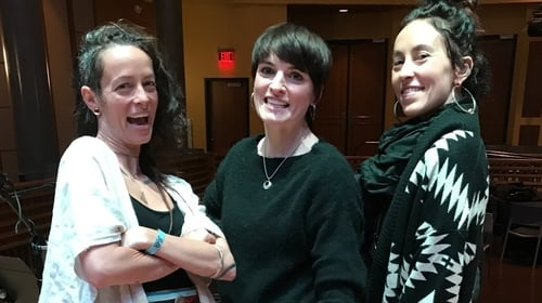 Simply Folk host Ruth Smith (centre) in New Orleans with musical duo Rising Appalachia