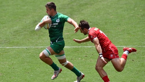 Ireland's Bryan Mollen rounds Pat Kay of Canada in the Sydney Sevens