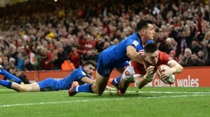 Wales winger Josh Adams dives over for his first try of the game against Italy