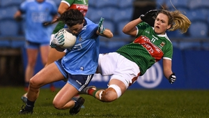 Leah Caffrey of Dublin ships a tackle from Fiona Doherty of Mayo at MacHale Park.