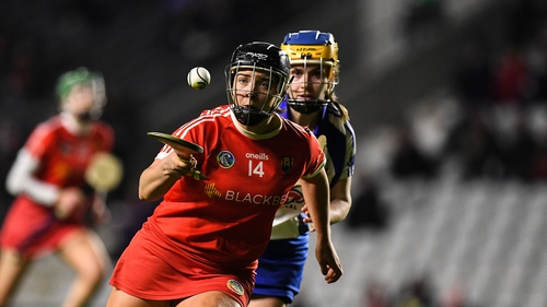 Linda Collins of Cork tries to evade Waterford's Kate McMahon during their National Camogie League Division 1 clash at at Páirc Uí Chaoimh.