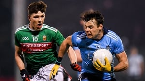Kevin McManamon in action against Fergal Boland