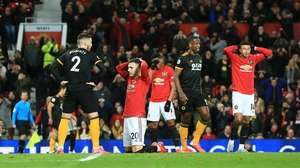 Diogo Dalot of Manchester United reacts to a missed chance against Wolves