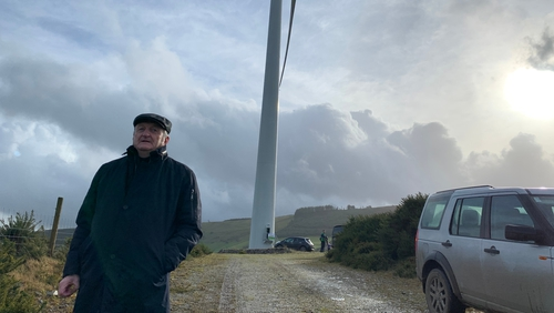 Co-founder John Fogarty in front of one of the two turbines