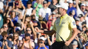 Webb Simpson celebrates his birdie on the first extra hole during the final round of the Phoenix Open