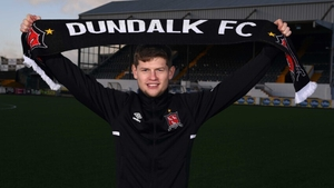 Cammy Smith poses with a Dundalk scarf