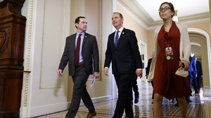 House impeachment managers Jason Crow (L) and Adam Schiff walk to the Senate chamber
