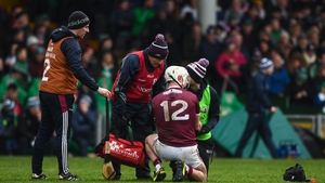 Joe Canning of Galway receives medical attention before being substituted during the Allianz Hurling match against Limerick