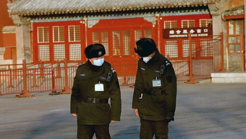 Police patrol the Forbidden City, which remains closed due to the coronavirus alert, in Beijing