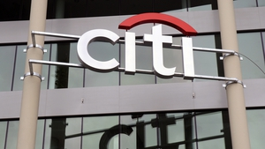 The US economic recovery has allowed Citigroup to release loan loss reserves and offset a plunge in revenue from lower trading and credit card lending
