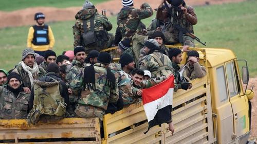Syrian Army soldiers advance towards Saraqeb in Idlib province
