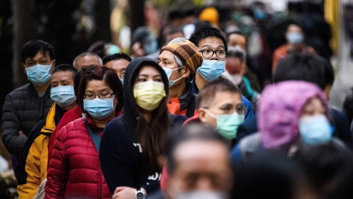 People in Hong Kong wear face masks as a protective measure