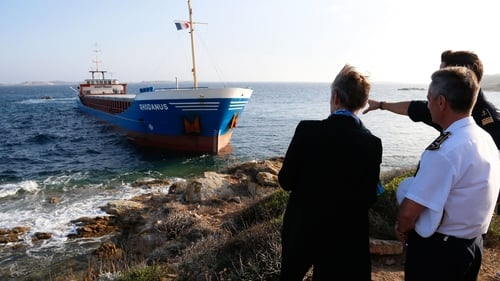 French Minister for the Ecological and Inclusive Transition Elisabeth Borne and Maritime Prefect Laurent Isnard look at the stranded ship