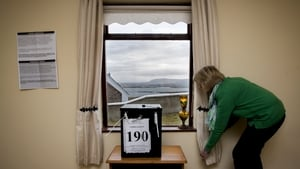 Nancy Sharkey sets up the polling station for the islanders