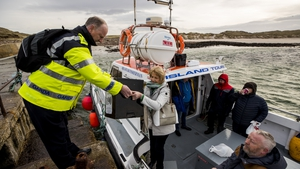 Garda Tom McBride is there to oversee proceedings and help take the ballot box off the boat