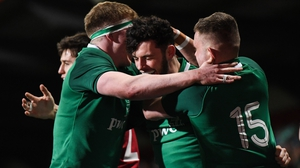Andrew Smith is congratulated by Sean O'Brien and Oran McNulty after scoring Ireland's fifth try of the night