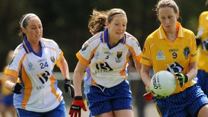 Caroline Conway in action against Lisa Brady (5), and Eadaoine Lenihan of Wicklow in the 2009 Division 3 league final.