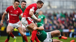 Hadleigh Parkes of Wales is tackled by Andrew Conway of Ireland
