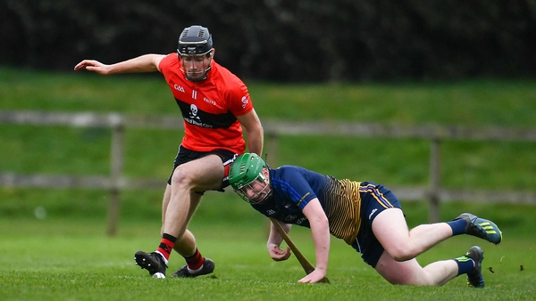 Conor Boylan of UCC in action against Evan Shefflin of DCU