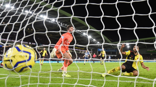 Adrian Mariappa puts the ball into his own net