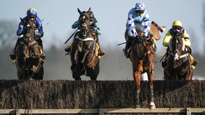 Altior (2L) and Nico de Boinville clear the water jump before going on to win at Newbury on Saturday.