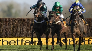 Nico de Boinville and Altior (L) pulled clear after the last to win at Newbury from Sceau Royal.