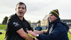 Referee Seán Hurson with Meath manager Andy McEntee