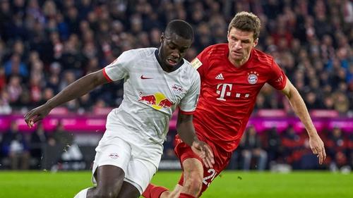Dayot Upamecano of RB Leipzig and Thomas Muellerof FC Bayern Munich
