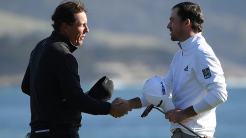Nick Taylor (R) shakes hands with Phil Mickelson after winning the AT&T Pebble Beach ProAm.