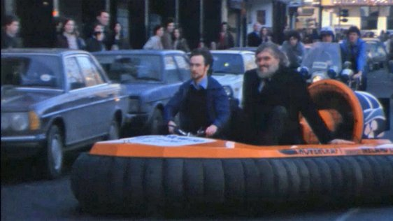 Richard Kiel on a Hovercraft in Dublin City Centre (1980)