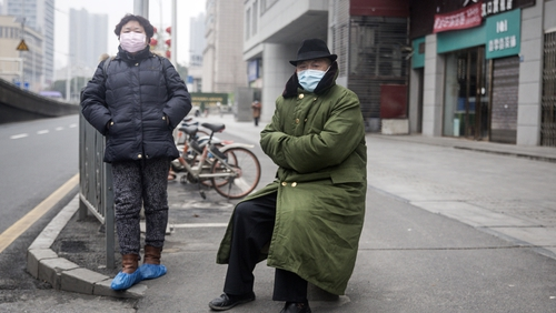 Two residents wear protective masks in Wuhan shortly after the outbreak began