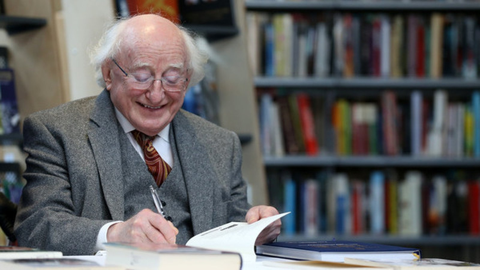 President Higgins donates books to public libraries