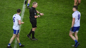 Ciaran Branagan pointing to watch after being confronted by Monaghan players on Saturday evening