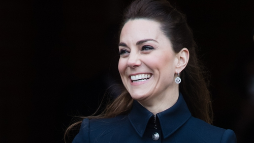 In a rare public appearance with her parents-in-law, Kate once again broke out a stunning Alexander McQueen military-style suit. Photo: Getty