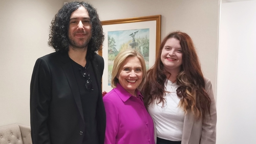 Emma DeSouza (R) and her husband Jake DeSouza with Hillary Clinton