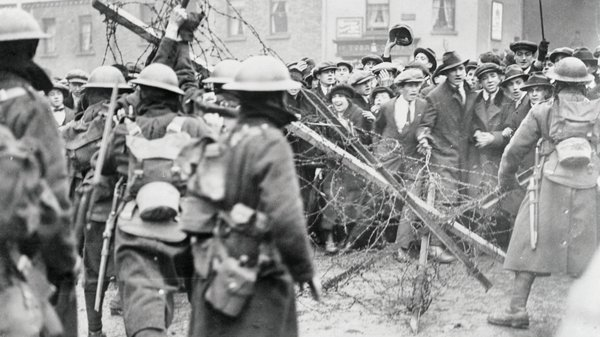 A crowd confronts British soldiers in Dublin in April 1920. Photo: Getty Images