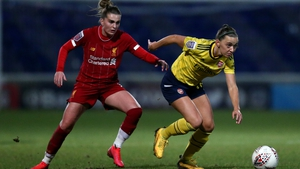 Katie McCabe of Arsenal (R) is challenged by Melissa Lawley of Liverpool